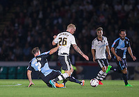 Garry Thompson of Wycombe Wanderers challenges Jack Grimmer of Fulham which results in the Fulham Player being stretchered off during the Capital One Cup match between Wycombe Wanderers and Fulham at Adams Park, High Wycombe, England on 11 August 2015. Photo by Andy Rowland.