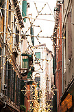 ITALY, Venice. Christmas decorations along an alley in Venice.