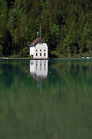 White lake side cottage.Lake Plansee near Reutte, Austrian Alps. Austria.