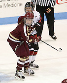 Dru Burns (BC - 7), Kelly Wallace (NU - 5) - The Northeastern University Huskies defeated Boston College Eagles 4-3 to repeat as Beanpot champions on Tuesday, February 12, 2013, at Matthews Arena in Boston, Massachusetts.