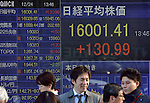 December 24, 2013, Tokyo, Japan - Japan's Nikkei share average breaks through the 16,000 mark for the first time in six years during midday trading on the Tokyo Stock Exchange market on Tuesday, December 24. 2013.  (Photo by Natsuki Sakai/AFLO)