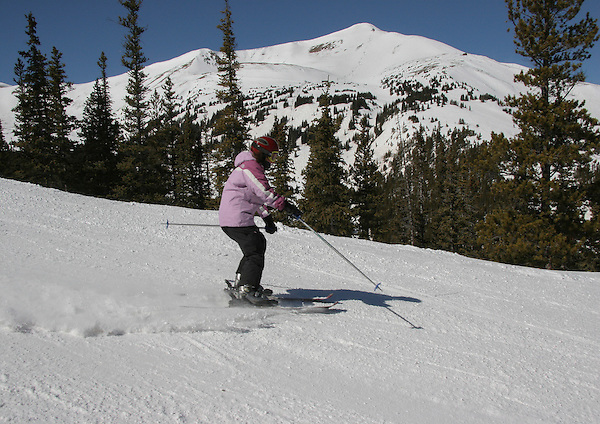 Woman skiing at Breckenridge Ski Area Colorado, .  John leads private ski trips to Front Range and Summit County Ski Areas in Colorado.