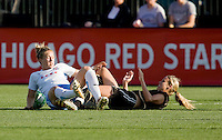 Ella Masar (left) collides with Leslie Osborne (right). FC Gold Pride tied the Chicago Red Stars 1-1 at Buck Shaw Stadium in Santa Clara, California on June 7th, 2009.