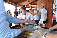 NWA Democrat-Gazette/FLIP PUTTHOFF <br /> Cindi Reynolds watches tournament officials get her fish ready to weigh Saturday May 5 2018 at the buddy bass tournament.