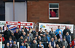 Dumfries Rangers fans and a resident getting a free view of the match