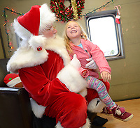 NWA Democrat-Gazette/ANDY SHUPE<br /> Rosie DeSonier, 4, of Bentonville laughs Saturday, Dec. 1, 2018, as she greets Santa Claus during the annual Christmas Train at the Arkansas &amp; Missouri Railroad in Springdale. The event features a 40-minute ride to Johnson and back aboard a 1940s-era passenger car with Christmas carols. Santa Claus sat for photographs with families in a caboose while games and pony rides were available at the depot.