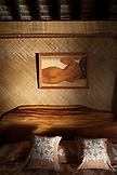 FRENCH POLYNESIA, Vahine Island. A bedroom with a painting at the Vahine Private Island Resort.