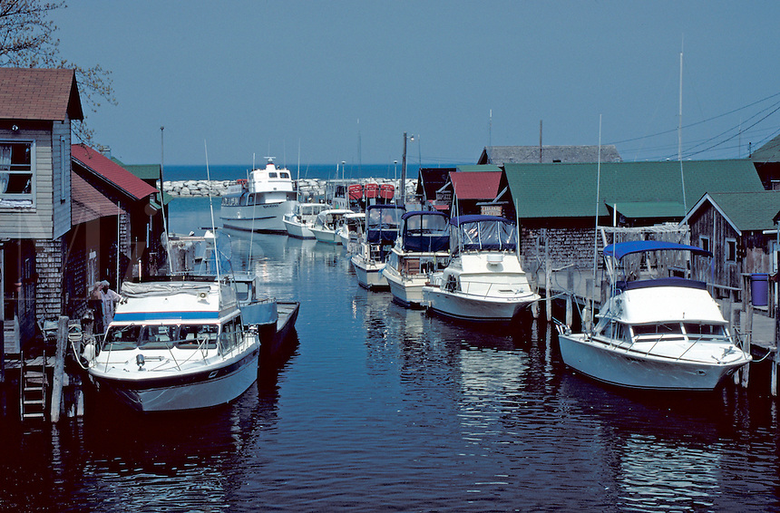 boats along docks at the Lake Michigan resort town. Leland Michigan USA.