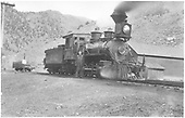 3/4 engineer's-side view of D&amp;RG #402 at Cimarron with engineer Denver &quot;Sap&quot; Richardson posing at her side.<br /> D&amp;RG  Cimarron, CO  ca 1905