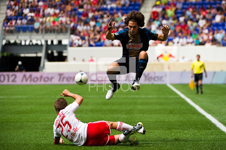 Gabriel Farfan (15) of the Philadelphia Union jumps over Brandon Barklage (25) of the New York Red Bulls. The New York Red Bulls defeated the Philadelphia Union 2-0 during a Major League Soccer (MLS) match at Red Bull Arena in Harrison, NJ, on July 21, 2012.
