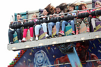 Pictured: People on the Shockwave at the fairground. Sunday, 01 June 2014<br />
