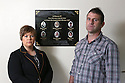 TO GO WITH IAN COBAIN FEATURE - JOB BOOKED BY GUY LANE:  Aidan O'Toole a  survivor of the 1994 gun attack, and Emma Rogan the daughter of Adrian Rogan a victim who was murdered by Loyalist gunmen in 1994 attack stand beside the memorial plaque inside the same room where the gun attack took place in the Bar as it is today. (2 Oct 2012). O'Tooles Bar is the only Pub in the small village of Loughinisland in County Down, Northern Ireland. On 18 June 1994 and The Ulster Volunteer Force (UVF), a loyalist paramilitary group, attacked the crowded pub with assault rifles killing six civilians and wounding five. The pub was targeted because those inside were believed to be Catholics. Photo/Paul McErlane