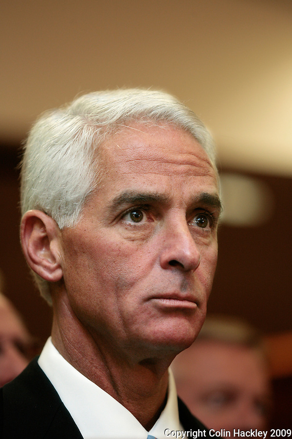 TALLAHASSEE, FL. 5/27/09-CRIST BUDGET CH06-Florida Gov. Charlie Crist listens to other speakers before signing Florida's 2009-10 budget May 27, 2009 at the Capitol in Tallahassee...COLIN HACKLEY PHOTO