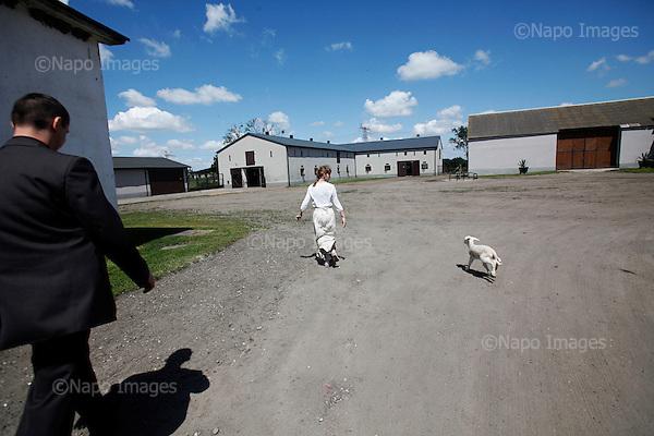 KUBALIN, POLAND, JUNE 16, 2010:.Jaroslaw Kaczynski on the campaign trail:.Ewelina Foltyn holds a sheep during J.Kaczynski's Visit at the farm of Malgorzata and Wojciech Foltyn in Kubalin, Western Poland. .(Photo by Piotr Malecki / Napo Images)..KUBALIN, 16/06/2010:.Jaroslaw Kaczynski - wizyta w gospodarstwie Malgorzaty i Wojciecha Foltyn..Fot: Piotr Malecki / Napo Images.