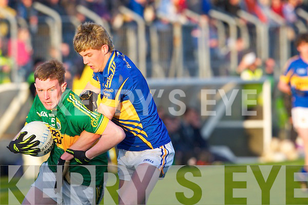 Kerry's Conor Keane and Tipperary's Stephen O'Brien in action in the Munster minor football championship at Austin Stack park, Tralee on Saturday.
