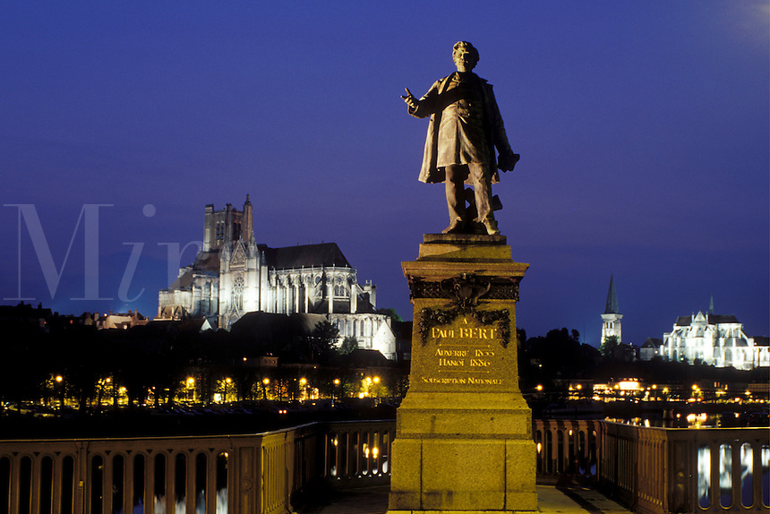 Auxerre, Burgundy, France, Yonne, Bourgogne, Europe, wine region, Statue of Paul Bert along the Yonne River in the city of Auxerre. Cathedral St. Etienne in the background.