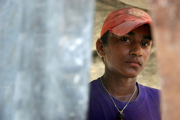 Like all teenagers in Thailand, Raoul likes football. His Manchester United cap is a prized possession. But then, he doesn't have many others, because Raoul is 15 and works on this construction site for US$3 a day.<br /> <br /> Like migrant communities all over the world, the Burmese in Thailand are often reviled by their hosts. as lazy, dirty and dishonest. The truth, as always, is completely different.