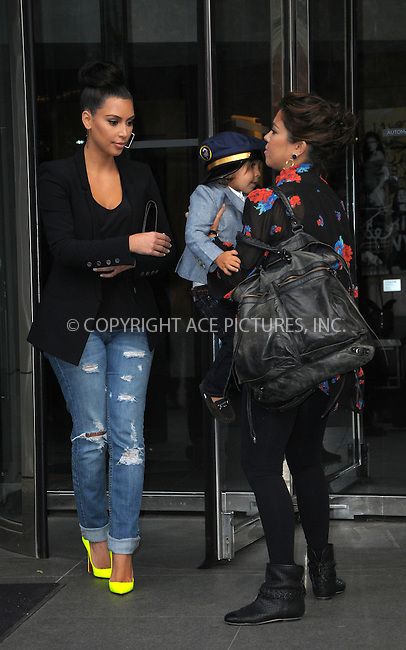 WWW.ACEPIXS.COM . . . . .  ....April 24 2012, New York City....Kim Kardashian (L) and Kourtney Kardashian take Kourtney's son Mason for a walk in the Meatpacking District on April 24 2012 in New York City....Please byline: CURTIS MEANS - ACE PICTURES.... *** ***..Ace Pictures, Inc:  ..Philip Vaughan (212) 243-8787 or (646) 769 0430..e-mail: info@acepixs.com..web: http://www.acepixs.com