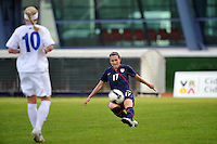 #17 Meghan Schnur of the US Women's National Soccer Team crosses the ball against Iceland at the 2010 Algarve Cup game in Vila Real Sto. Antonio, Portugal.