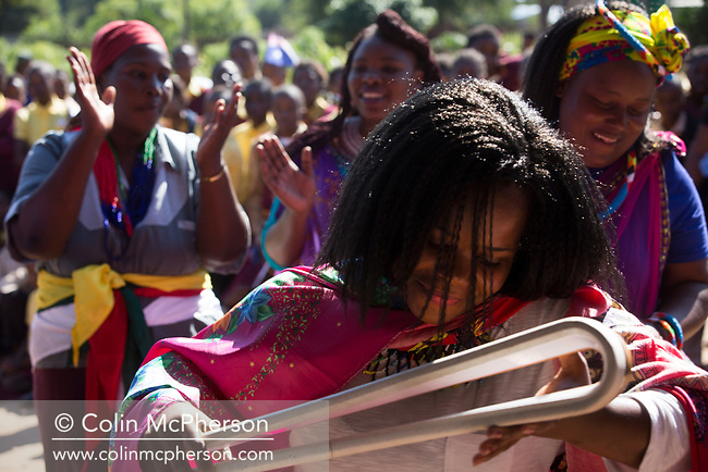 The Queen's Baton spent the day in the Mpumalanga province, South Africa on 19 May, 2017, where it visited notable tourist attractions and interacted with groups of school pupils and a village community. This Queen's Baton Relay will visit all 70 nations and territories of the Commonwealth, over 388 days and cover 230,000km. It will be the longest Relay in Commonwealth Games history, finishing at the Opening Ceremony on the Gold Coast on 4th April 2018. Photograph show a parent with the Baton at Mvuyazi primary school in the village of Cork.