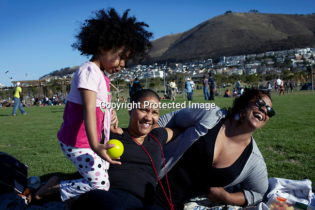 CAPE TOWN, SOUTH AFRICA - OCTOBER 16: Nicole and Gaye Rudling, a married couple with their adopted daughter Malia, age 3 on October 16, 2011 in Cape Town, South Africa. They live in Cape Town, a city known for tolerating gays and lesbians except in the townships where they get harassed and often attacked. They play in a park in Green Point area of Cape Town. (Photo by Per-Anders Pettersson)