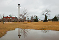 Wind Point Lighthouse reflects in a rain pond on a gray winter day, Wind Point, Racine County, Wisconsin