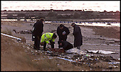 Police investigate the scene at Barrassie beach where human remains were found .... Pic Donald MacLeod