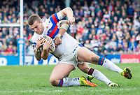Picture by Allan McKenzie/SWpix.com - 08/04/2018 - Rugby League - Betfred Super League - Wakefield Trinity v Leeds Rhinos - The Mobile Rocket Stadium, Wakefield, England - Max Jowitt is tackled.