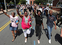 Demonstrators marched from Washington Park to the Downtown Mall on the anniversary of August 12th Sunday in Charlottesville. Photo/Andrew Shurtleff