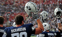 Sept. 19, 2009; Provo, UT, USA; BYU Cougars offensive lineman Jordan Richardson holds his helmet up with teammates during the kickoff for the game against the Florida State Seminoles at LaVell Edwards Stadium. Florida State defeated BYU 54-28. Mandatory Credit: Mark J. Rebilas-