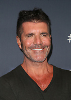 """HOLLYWOOD, CA - SEPTEMBER 10: Simon Cowell, at """"America's Got Talent"""" Season 14 Live Show Red Carpet at The Dolby Theatre  in Hollywood, California on September 10, 2019. Credit: Faye Sadou/MediaPunch"""