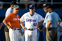 May 30, 2009:  NCAA Division 1 Gainesville Regional:    Florida assistant coach  Brad Weitzel (42) and Miami coach Jim Morris (3) meet with umpires prior to the start of 2nd round regional action at Alfred A. McKethan Stadium on the campus of University of Florida in Gainesville. Host University of Florida Gators defeated Miami Hurricanes  8-2 to advance in the Winners bracket.............
