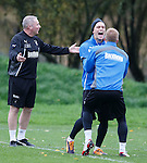 Nicky Law and Stevie Smith laugh at the gaffer as he is caught out at training