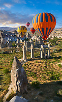 "Pictures & images of hot air balloons over the fairy chimney rock formations and rock pillars of ""love Valley"" near Goreme, Cappadocia, Nevsehir, Turkey"
