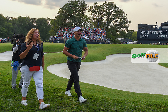 Brooks Koepka (USA) and his Mom depart the green on 18 after winning the 100th PGA Championship at Bellerive Country Club, St. Louis, Missouri. 8/12/2018.<br /> Picture: Golffile | Ken Murray<br /> <br /> All photo usage must carry mandatory copyright credit (© Golffile | Ken Murray)