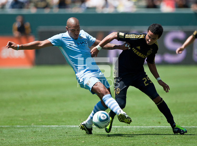 CARSON, CA – July 24, 2011: Nigel de Jong (34) of Manchester City and Miguel Lopez (25) of LA Galaxy during the match between LA Galaxy and Manchester City FC at the Home Depot Center in Carson, California. Final score Manchester City FC 1 and LA Galaxy 1. Manchester City wins shoot out 7, LA Galaxy 6.