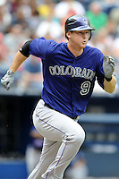 Colorado Rockies second baseman D.J. LeMaieu #9 runs to first during a game against the Atlanta Braves at Turner Field on September 3, 2012 in Atlanta, Georgia. The Braves  defeated the Rockies 6-1. (Tony Farlow/Four Seam Images).