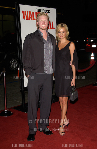 Actor JAKE BUSEY & girlfriend SHERYL CHAMBERS at the world premiere, in Hollywood, of Walking Tall..March 29, 2004