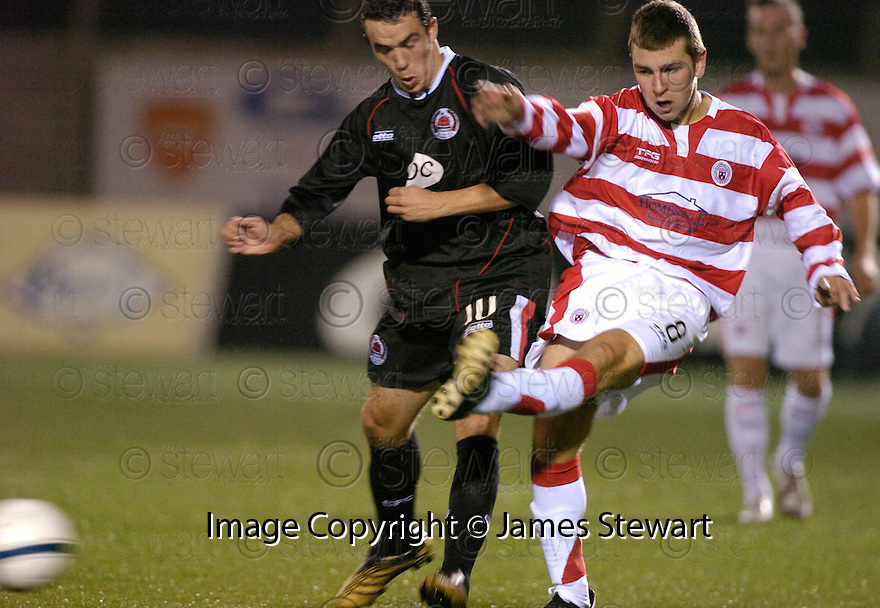 17/10/2006       Copyright Pic: James Stewart.File Name :sct_jspa02_hamilton_v_clyde.CLYDE'S DOUGIE IMRIE TACKLES JAMES MCARTHUR... IMRIE WAS BOOED ALL NIGHT BY THE HAMILTON FANS....Payments to :.James Stewart Photo Agency 19 Carronlea Drive, Falkirk. FK2 8DN      Vat Reg No. 607 6932 25.Office     : +44 (0)1324 570906     .Mobile   : +44 (0)7721 416997.Fax         : +44 (0)1324 570906.E-mail  :  jim@jspa.co.uk.If you require further information then contact Jim Stewart on any of the numbers above.........