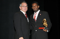 DC United forward Luciano Emilio receiving the Budweiser Golden Boot from DC United general manager Dave Kasper, he got the award for 10 goals score in the season.   At the 6th Annual DC United Awards Presentation ,at the Atlas Performing Arts Center in Washington DC ,Wednesday October 27, 2009.