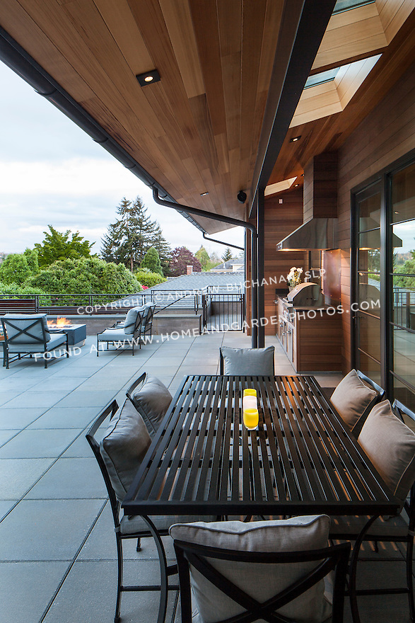 Patio area with outdoor dining table and firepit