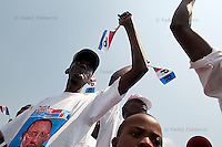 Supporters of Rwandan president Paul Kagame wait for his arrival at the presidential campaign rally in Gisagara District, Rwanda. July 28 2010