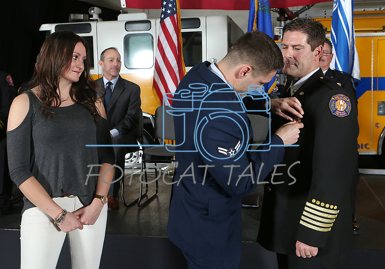 Carson City Fire Department's new Chief Sean Slamon receives his badge from his son Zachary and his daughter Courtney during a ceremony in Carson City, Nev., on Friday, March 31, 2017. <br />Photo by Cathleen Allison/Nevada Photo Source