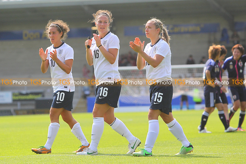 England players applaud the fans at the final whistle - England Women vs Japan Women - Friendly Football International at the Pirelli Stadium, Burton Albion FC - 26/06/13 - MANDATORY CREDIT: Gavin Ellis/TGSPHOTO - Self billing applies where appropriate - 0845 094 6026 - contact@tgsphoto.co.uk - NO UNPAID USE