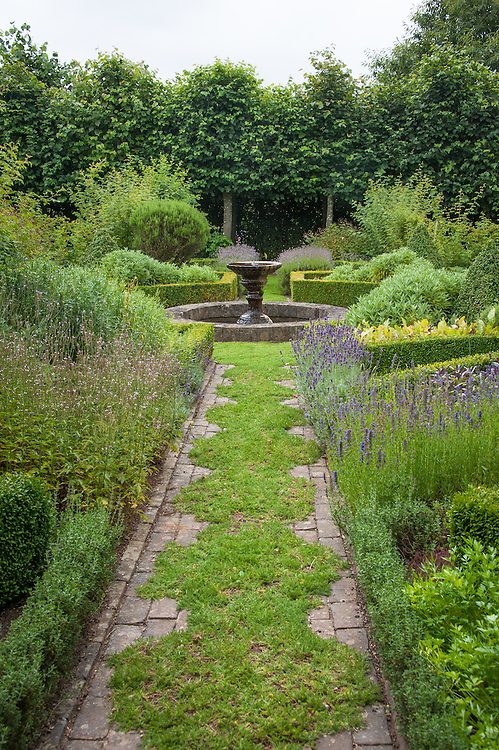 "The Herb Garden at Clinton Lodge Garden, Fletching, East Sussex, early August. ""The paths of camomile are designed to release their fragrance at the touch of a foot, or in earlier centuries the hem of a long dress."""