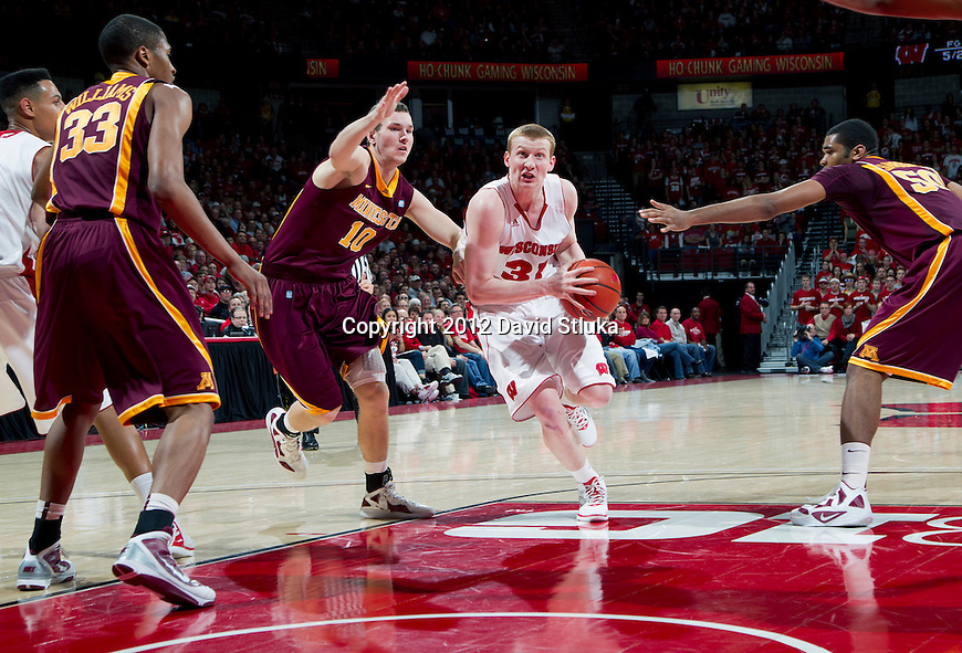Wisconsin Badgers forward Mike Bruesewitz (31) drives to the basket during a Big Ten Conference NCAA college basketball game against the Minnesota Golden Gophers on Tuesday, February 28, 2012 in Madison, Wisconsin. The Badgers won 52-45. (Photo by David Stluka)