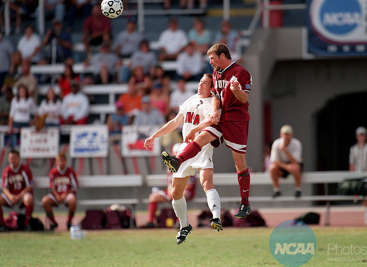 02 DEC 2001:  Midfielder Jeff Foxenberger (07)  of the University of Tampa and defender Nathan Reeves (14) of Cal-State Dominguez Hills go up for a header during the Divison 2 Men's Soccer Championship held at Pepin/Rood Stadium on the University of Tampa campus in Tampa, FL.  Tampa defeated Cal-State Dominguez Hills  2-1 for the national title.   Jason Behnken/NCAA Photos