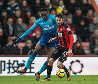 Adam Smith of AFC Bournemouth & Danny Welbeck of Arsenal during the Premier League match between Bournemouth and Arsenal at the Goldsands Stadium, Bournemouth, England on 14 January 2018. Photo by Andy Rowland.