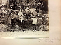 BNPS.co.uk (01202 558833)<br /> Pic: DominicWinterAuction/BNPS<br /> <br /> 'Exeter' Winner of the Hong Kong Challenge Cup in 1869 - Horse racing was an early arrival in the booming settlement.<br /> <br /> Revealed - A fascinating photo album from the very early days of British Hong Kong...long before the skyscrapers covered it over.<br /> <br /> The 150 year old photos of Hong Kong taken by one of the first British photographers to venture to the Far East have emerged for sale for £15,000.<br /> <br /> John Thomson, who was also a geographer, left Edinburgh for Singapore in 1862 and spent the following decade travelling the region.<br /> <br /> He explored a decidely low-rise Hong Kong from 1868 to 1870, taking numerous pictures of the rapidly expanding settlement and its industrious inhabitants.<br /> <br /> They capture the area, which is currently engulfed in unrest and protest, at a far more tranquil time.<br /> <br /> The photos are being sold with auction house Dominic Winter, of Cirencester, Gloucs.