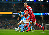 9th January 2018, Etihad Stadium, Manchester, England; Carabao Cup football, semi-final, 1st leg, Manchester City versus Bristol City; Raheem Sterling of Manchester City is challenged by Hordur Magnusson of Bristol City